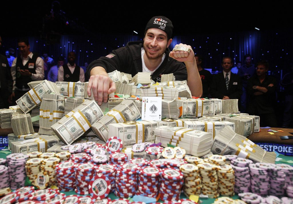 Jonathan Duhamel poses for photos after winning the World Series of Poker, Monday, Nov. 8, 2010 in Las Vegas. (AP Photo/Isaac Brekken)
